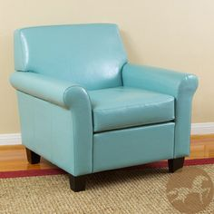 Add extra seating space and a pop of color to the room with this comfortable leather club chair with contrasting black finish. The attractive teal blue chair, featuring bonded leather that's made to last, is the ideal choice for a family room or den. Furniture, Room, Living Room Furniture, Blue Chair, Home, Leather Club Chairs, Teal Chair, Club Chairs, Extra Seating Space