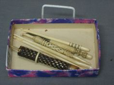 """2 ivory needle cases in the form of a parasol 5 1/2"""", a bodkin with turned ivory handle 4"""" and 3 ivory crochet hooks"""