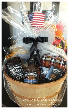 Wine Basket Gift Ideas Discover Custom JD Whiskey Barrel Gift Basket Containing: Honey Whiskey Original Whiskey Gentlemens Whiskey JD Punch Cocktails Nuts BBQ Sauce Whiskey & Shot Glasses Topped w/American Flag & Hand-Tied Bow. Alcohol Gift Baskets, Liquor Gift Baskets, Gift Baskets For Men, Alcohol Gifts, Themed Gift Baskets, Raffle Baskets, Wine Baskets, Basket Gift, Honey Whiskey