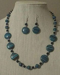 Check out this item in my Etsy shop https://www.etsy.com/listing/520680601/turquoiseblackorange-striped-disks-beads
