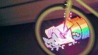 Gato cagando un arcoiris