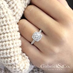"""Gabriel & Co. - Voted #1 Most Preferred Bridal Brand. """"To new beginnings and never endings."""" A detailed pave setting with diamonds that lace the band and halo. This contemporary styled engagement ring is truly enchanting."""