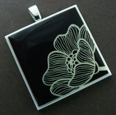 Cream and Brown Art Deco Flower Polymer Clay Photo Pendant, via Flickr.