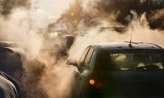 Smoke and steam rises from cars stuck in traffic in central Moscow, Russia, as the temperature drops there to minus -15C.