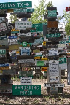 """Signpost Forest, Watson Lake, Yukon.  Find Germany,14, the word """"married"""", and 1997.  06/2013."""
