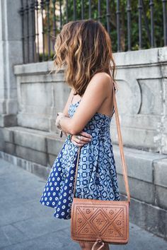 Sara Escudero is wearing a dress from Zara and a bag from Princess