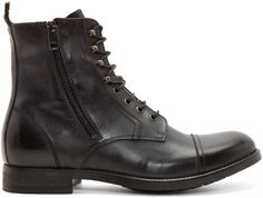 Burnished leather ankle boots in black. Round toe. Tonal lacing. Zippers on either side in matte gunmetal. Textile pull-tab at heel collar. Stacked leather heel. Rubber panels at sole. Tonal stitching.