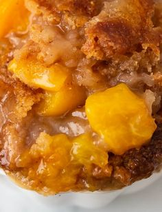 Peach Cobbler - Get excited because this is the best and easiest DELICIOUS peach cobbler recipe ever with a buttery crisp topping the melts in your mouth. It's NOT bready or cakey at all. The peaches stew in a sweet rich caramel sauce as it bakes. You can make it all year round because you can use canned or fresh peaches. This has become my family favorite dessert! Make it for your guests this summer! They will be begging for the recipe!