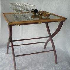 Use a luggage rack and framed print to create an impromptu table for a cocktail party