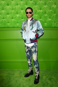 Jared Leto in a Gucci DIY embroidered silk bomber jacket, acid bleached jeans and Dionysus boots.