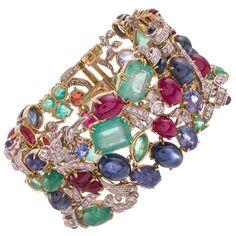 Seaman Schepps Gem Set Diamond Gold Tutti Frutti Garden Cuff Bracelet | From a unique collection of vintage cuff bracelets at https://www.1stdibs.com/jewelry/bracelets/cuff-bracelets/