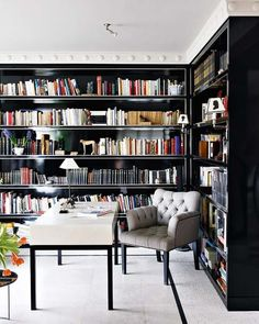 black bookcases.  love this entire space