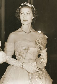 anythingandeverythingroyals: Princess Margaret wearing the Cartier Scroll/Halo Tiara and the family orders of her father King George VI and her grandfather King George V