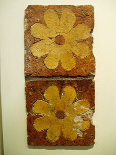 Medieval tiles  on display in museum, Winchester, England