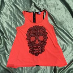 🎉 Free with purchase 🎉 This is a bright coral zip back racerback tank top with a black lace sugar skull printed on the front. Euro 34/ US 4 but fits like a small. DIVIDED brand my H&M. Divided Tops Tank Tops