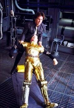 Harrison Ford trying to help Anthony Daniels get up on set of Star Wars