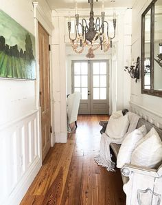 photo: very cute hallway has a pew lining one wall with cream accent pillows and lap blankets ...it is cute, that's why I'm saving...I like the look...but why, seriously, why?? would anyone need a pew/couch in the hallway??...have a lot of people that enjoy just staring at that painting and the walls, do we??...