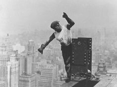 Construction worker on top of Empire State Building, New York 1930, photographed by Lewis Hine