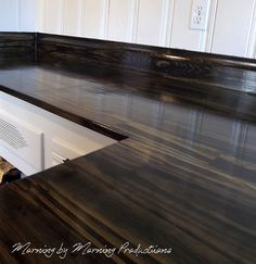 Clever and beautiful kitchen counters from stained plywood. Love the texture and sheen!