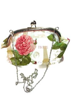 This feminine clutch purse is sewn from a romantic Paris themed fabric, with the interior made from a matching solid green fabric. I embellished this kisslock purse with dainty seed beads on the pink…More Personalized Makeup Bags, Personalized Mugs, Personalized Wedding Gifts, Crossbody Clutch, Clutch Purse, Coin Purse, Custom Makeup Bags, Romantic Paris, Bridesmaid Clutches