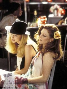 """Left to right: Rollergirl (Heather Graham) and Amber Waves (Julianne Moore) in director Paul Thomas Anderson's """"Boogie Nights"""" Heather Graham Boogie Nights, Heather Graham Movies, Julianne Moore, Image Film, Plunge Dress, Julie, Film Stills, Best Actress, Costume Design"""
