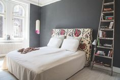 The headboard is made of a mattress that can also be used as a guest bed. Cool solution!