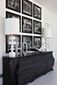 entrances/foyers - distressed credenza, glossy white lamps, photo walls, photo wall collage, photo wall ideas, photo wall gallery, via Pint...
