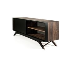 This elegantly designed Octanov commode can stand alone in a room or against a wall. Formed of solid wood, it has two sliding doors with detailed cut-outs..