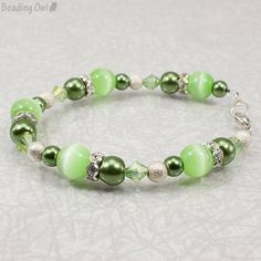 Green cats eye beaded bracelet features an array of cats eye beads, pearls, crystals and silver plated rondels accents to add sparkle to your wrist. Product Details Bracelet Length: 7-1/4 inches Closure: Lobster Claw Clasp Color(s): Green, Silver, Peridot Product ID: B282.01