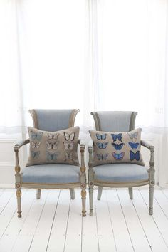 Butterfly motif hand-embroidered cushions - In shades ranging from white, cream and soft duck egg blue, through to rich cobalt hues, the colours highlight the incredible tones of the Cabbage White and British Blue butterfly families.