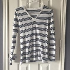 Gap stripped vneck shirt Black and white stripped long sleeve vneck tshirt from the Gap. GAP Tops