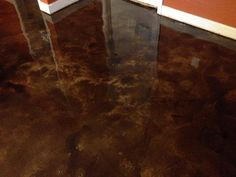 This brown and tan stained concrete floor creates a really natural polished stone look and feel for this residence. Polished Concrete Floor Cost, Residential Concrete Floors, Concrete Repair Products, Rustic Sofa, Stained Concrete, Concrete Staining, Concrete Wall, Concrete Overlay, Epoxy Floor