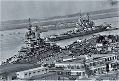 Battleship New Mexico (BB-40) being brought into Boston Navy Yard on 17 Oct 1945. The battleship North Carolina (BB-55) anchored there also, and after overhaul at NY exercised in New England waters .