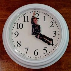 Cheap clock from Ikea. Pop open and glue cut out picture on hands. Easy! Great gift for Father's Day.