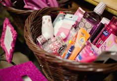 """I took this idea from a blog I read on theknot.com entitled """"Do These 13 Things To Make Guests Happy!"""" This one is captioned: """"Pamper Them With a Bathroom Basket!"""" This is a great idea, especially for the out of town guests who may not have remembered to put tylenol in their purse! Photo: The Busy Broad // Featured: The Knot Blog"""