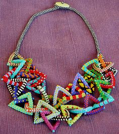 NITA E. KAUFMAN - Added a second layer of triangles to existing necklace. Used new patterned pieces.
