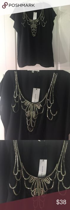 "Collective Concepts Black Beaded Blouse! Size L. Gorgeous blouse from Collective Concepts - features a beaded bib - can be dressed up or down - from work to downtown! Blouse is flowy without being sloppy. Measures approximately 26"" from top to bottom and approximately 21"" across the bust. Purchased in a boutique for $95 - it's been in my closet - but now I'm moving and must downsize! 100% polyester! Collective Concepts Tops Blouses"