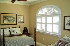 Plantation shutters with an eyebrow arch