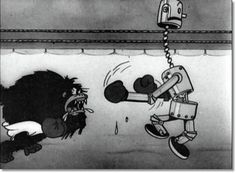 Still from the Mickey Mouse cartoon 'Mickey's Mechanical Man' (1933) featuring a gorilla boxing with a robot