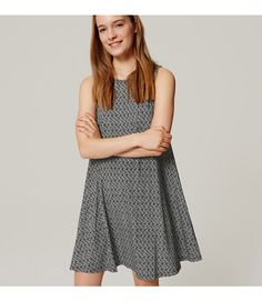 """We're into free-spirited feel of this striking style. Jewel neck. Sleeveless. 19"""" from natural waist."""