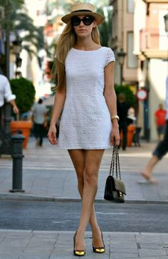 White Shift Dress, Black and Gold Pumps with Chanel Bag. Straw Hat and Black Shades complete look!