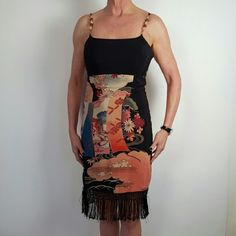 Sue Wang Dress Beautiful Crystal Stones on Shoulder Straps.  Crochet Fringe on Bottom of Dress. Black Lining. Invisible Zipper in Back.  100% Silk.  Colors:  Black, Orange, Red, Blue, Beige. Very Classy Dress. Sue Wong Dresses Midi