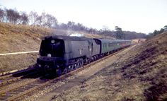 https://flic.kr/p/NZFuwb   The 'Brighton'   Battle of Britain Pacific 34057 'Biggin Hill' races down Hinton Bank with the Brighton to Bournemouth Sundays only through train in the winter of 1963.
