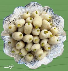 Toot - Persian Marzipan Mulberry.  A lovely confection that is traditionally served at weddings and for Norooz.  Very easy recipe.  Addictive little suckers.