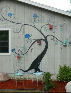 Side of a shed.Nice way to display bird houses
