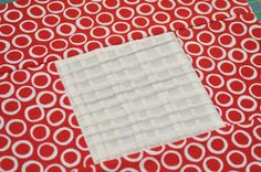 Block type: log cabin Block size: 11 inches Colour scheme: reds and neutrals Texture/fabric manipulation: cross tucking Quilt size: The finished quilt is 52 ½ x 52 ½. Needs: one 10 in x 10 in squar...