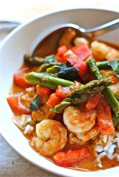 Thai Shrimp Curry:  2 cups cooked jasmine or basmati rice   * 1/2 pound shrimp, peeled and deveined   * 1 (14.5 oz) can coconut milk   * 3 Tbs. red Thai curry paste   * 1 Tbs. brown sugar   * 1/2 red bell pepper, finely sliced   * 1/2 bunch asparagus, ends trimmed and cut into 1-inch pieces   * 1 lime   * 1/4 cup fresh basil, torn
