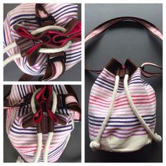 Descripción: bolso mochila Color: fucsia, café morado  Medida: 40cm x 35cm Material: algodón y cuero sintético.