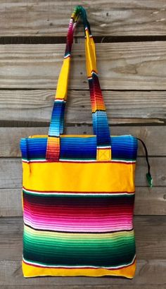 Super cute, stylish and colorful! Measures 14x14x4 with 30 inch straps. Zipper top closure. Fully lined.
