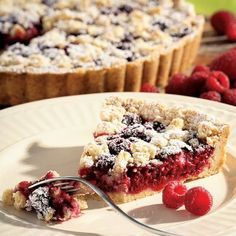 With fresh summer fruit and a crust that also doubles as a topping, this Raspberry-Almond Crumb Tart is one of our favorite easy, yet impressive, desserts to bring a BBQ.